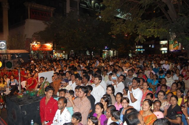The MG Road crowd look on during the Light Up Pune show