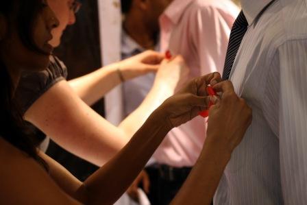 Pinning AIDS ribbons
